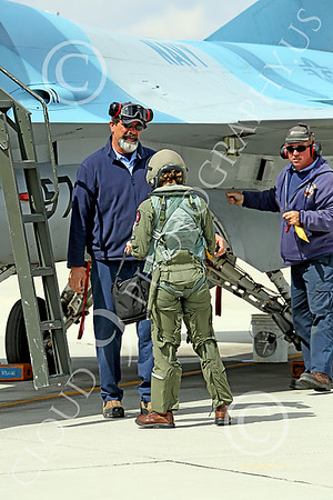 ACM 00409 One of three USN F-16 fighter pilots is short compared to male ground support techs at NAS Fallon, military airplane picture by Peter J Mancus