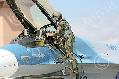 ACM 00408 One of three USN F-16 fighter pilots deplanes her ride at NAS Fallon military airplane picture by Peter J Mancus