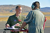 ACM 00434 Portrait of an Oregon Air National Guard F-15 Eagle jet fighter pilot with his crew chief and a maintenance log for his jet at Reno Air Races 2016, by Peter J  Mancus