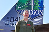 ACM 00428 Portrait of an Oregon Air National Guard F-15 Eagle jet fighter pilot by tail of his rare special color scheme jet fighter at Reno Air Races 2016, by Peter J  Mancus