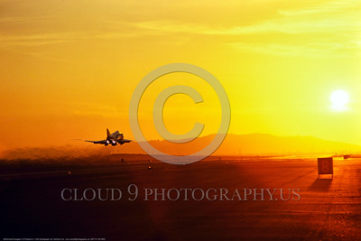 ARTY-F-4II 0002 A USN McDonnell Douglas F-4 Phantom II jet fighter takes off from a land air base in full afterburner at sunset , USN photo via Tailhook Col  produced by Cloud 9 Photography     DONEwt