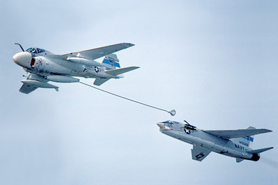 AAR 00054 A USN Grumman KA-6B Intruder PMTC refuels a USN Vought F-8 Crusader PMTC military airplane picture by Michael Grove, Sr
