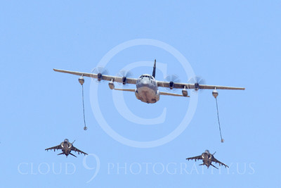 AAR 00107 A USMC Lockheed KC-130 Hercules and two USMC McDonnell Douglas AV-8B VSTOL jet attack aircraft prepare to aerial refuel airplane picture, by Peter J Mancus