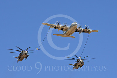 AAR 00119 A USMC Lockheed KC-130 Hercules and two USMC Sikorsky CH-53 Sea Stallion helicopters prepare to aerial refuel airplane picture, by Peter J Mancus