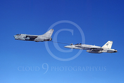 AAR 00053 A USN Vought A-7 Corsair II refuels a USN McDonnell Douglas F-18 Hornet jet fighter VFA-303 GOLDEN HAWKS military airplane picture by Michael Grove, Sr