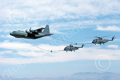 AAR 00050 A Lockheed HC-130 Hercules USAF refuels two Sikorsky HH-3 USAF helocopters military airplane picture by Michael Grove, Sr