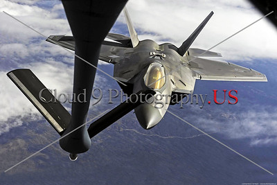AR-F-22-USAF 002 A Lockheed Martin USAF F-22 Raptor stealth air supremacy jet fighter doing aerial refueling over clouds, official USAF picture produced by Cloud 9 Photography     Dt