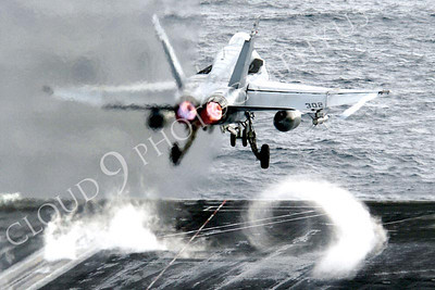 """040601-N-9769P-013 Gulf of Alaska (Jun. 1, 2004) - An F/A-18C Hornet from the """"Stingers"""" of Strike Fighter Squadron One One Three (VFA-113) launches off the bow of USS John C. Stennis (CVN 74) during afternoon flight operations.  Stennis and her embarked Carrier Air Wing Fourteen (CVW-14) are currently at sea conducting a scheduled deployment.  U.S. Navy photo by Photographer's Mate 2nd Class Jayme Pastoric. (RELEASED)"""