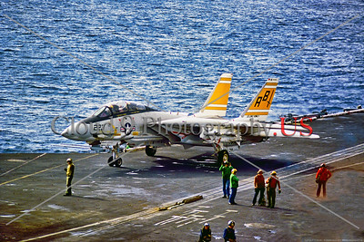 F-14USN-VF-32 002 An armed Grumman F-14 Tomcat, USN carrier based swing wing jet fighter, VF-32 SWORDSMEN, taxis on USS John F  Kennedy's very worn flight deck, 1974, by  Charles Canco, Stephen W  D  Wolf coll    DDD_3835     Dt
