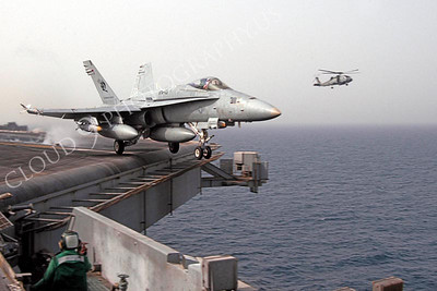 An F/A-18C Hornet assigned to Strike Fighter Squadron ONE ONE THREE (VFA 113) launches off the waist catapult on March 20, 2003.USS Abraham Lincoln (CVN 72) and Carrier Air Wing FOURTEEN (CVW 14) are conducting combat operations in support of Operation Iraqi Freedom. (U.S. Navy photo by Photographer's Mate Third Class (AW/PJ) Philip A. McDaniel)(Released)