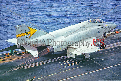 F-4II-USN-VF-103 001 A McDonnell Douglas F-4J Phantom II US Navy carrier borne jet fighter, 153877, VF-103 SLUGGERS, on USS Saratoga 1-1980, in afterburner on catapault, military airplane picture by Pete Clayton     Dt copy