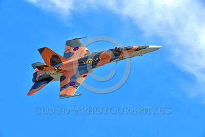 F-18Forg 00306 A flying, banking, Canadian Armed Forces McDonnell Douglas CF-18 Hornet jet fighter 188761 with rare Battle of Britian color scheme military airplane picture at 5-2015 Chino air show by Peter J Mancus
