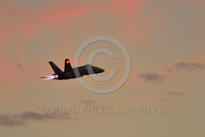 F-18Forg 00310 A flying Canadian Armed Forces McDonnell Douglas CF-18 Hornet jet fighter 188761 in afterburner with rare Battle of Britian color scheme military airplane picture during twilight 5-2015 Chino air show by Peter J Mancus