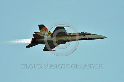 F-18Forg 00308 A flying Canadian Armed Forces McDonnell Douglas CF-18 Hornet jet fighter 188761 with rare Battle of Britian color scheme in afterburner during a twilight 5-2015 Chino air show by Peter J Mancus