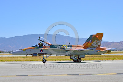 F-18Forg 00305 A taxing Canadian Armed Forces McDonnell Douglas CF-18 Hornet jet fighter 188761 with rare Battle of Britian color scheme military after a flight display airplane picture at 5-2015 Chino air show by Peter J Mancus
