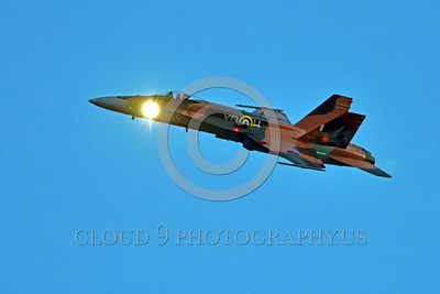 F-18Forg 00312 A Canadian Armed Forces McDonnell Douglas CF-18 Hornet jet fighter 188761 in Battle of Britian markings with search light on for night identification of unknown aircraft during a twilight 5-2015 Chino air show by Peter J Mancus