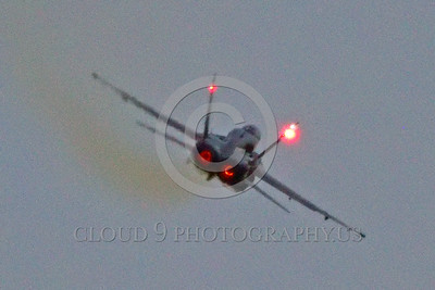 F-18Forg 00301 A Canadian Armed Forces McDonnell Douglas CF-18 Hornet jet fighter 188761 in rare Battle of Britian colors in afterburner military airplane picture during twilight 5-2015 Chino air show by Peter J Mancus