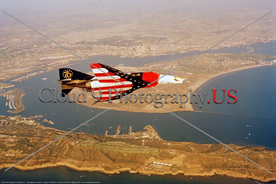 BIC-F-4USN 0012 A colorful flying McDonnell Douglas F-4 Phantom II USN in US Bicentennial markings over NAS North Island 4-1976 military airplane picture by Robert L  Lawson    Dwt