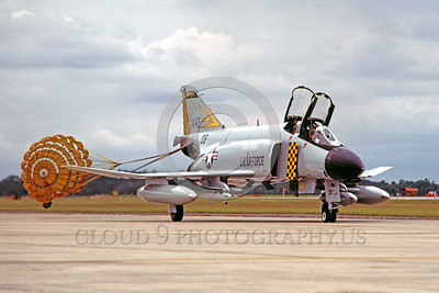 CHUTE-F-4ANG 00017 A McDonnell Douglas F-4 Phantom II Michigan ANG Tyndall AFB 10-1980 taxis with chute deployed military airplane picture by Peter J Mancus