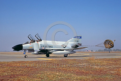 CHUTE-F-4ANG 00006 A McDonnell Douglas F-4 California ANG Fresno 12-1985 taxis with chute military airplane picture by Peter J Mancus