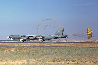 CHUTE-B-52 00001 A Boeing B-52 Stratofortress USAF strategic bomber rolls out at Castle AFB with deployed chute military airplane picture by Peter J Mancus