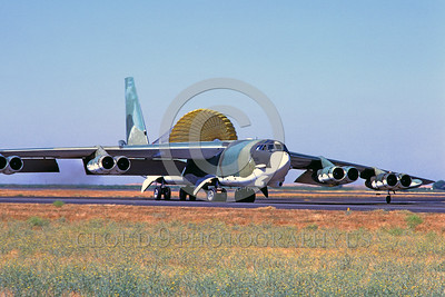 CHUTE-B-52 00002 A Boeing B-52 Stratofortress USAF strategic jet bomber taxis at Castle AFB with deployed chute military airplane picture by Peter J Mancus