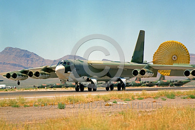CHUTE-B-52 00012 A Boeing B-52 Stratofortress USAF strategic jet bomber rolls out with deployed chute at Nellis AFB military airplane picture by Peter J Mancus