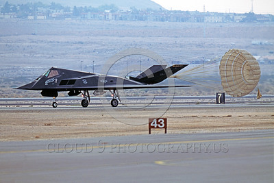 CHUTE-F-117 00002 A Lockheed F-117 Nighthawk stealth bomber HO code with many mission markings rolls out with deployed chute Nellis AFB 11-2003 military airplane picture by Peter J Mancus