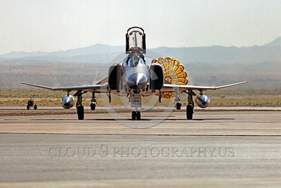 CHUTE-F-4USAF 00001 A McDonnell Douglas F-4 Phantom II USAF jet fighter taxis with chute Nellis AFB military airplane picture by Peter J Mancus