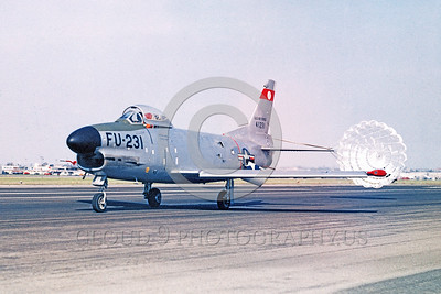 CHUTE-F-86USAF 00001 A taxing North American F-86K Sabre jet fighter with deployed chute official USAF photograph produced by Cloud 9 Photography