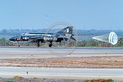 CHUTE-F-4USN 00011 A McDonnell Douglas F-4 Phantom II USN jet fighter VX-4 THE EVALUATORS rolls out with chute NAS Pt Mugu 10-1989 military airplane picture by Peter J Mancus