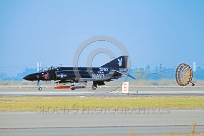 CHUTE-F-4USN 00009 A McDonnell Douglas F-4 Phantom II USN jet fighter VX-4 THE EVALUATORS rolls out with chute NAS Pt Mugu 11-1977 military airplane picture by Peter J Mancus