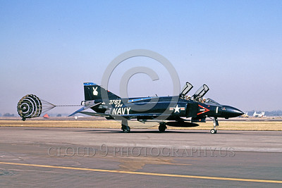 CHUTE-F-4USN 00001 A McDonnell Douglas F-4 Phantom II USN jet fighter VX-4 THE EVALUATORS taxis with chute NAS Pt Mugu military airplane picture by Peter J Mancus
