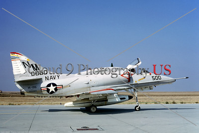 A-4USN-VA-195 001 A static USN Douglas A-4C Skyhawk attack jet, 142900, VA-195 DAM BUSTERS, USS Oriskany, commander's plane, NM  code, NAS Lemoore 11-1968, military airplane picture by Duane A Kasulka     DT copy