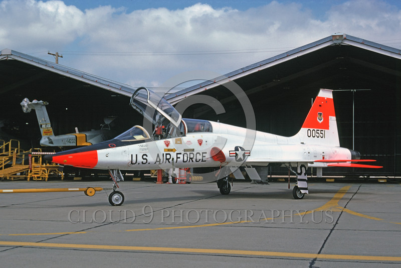 DG-T-38USAF 0001 A static day-glow Northrop T-38 Talon USAF jet trainer 00551 McClellan AFB 5-1975 military airplane picture by Peter B Lewis