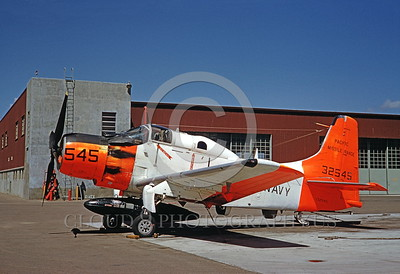 DG-A-1USN 0003 A static day-glow Douglas A-1 Skyraider US Navy 32545 4-1961 Pacific Missile Range military airplane picture by Clay Jansson