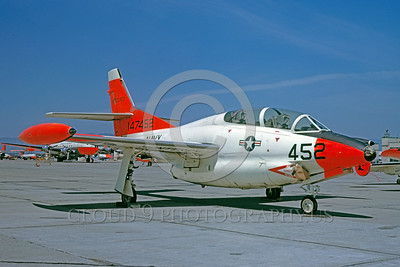 DG-T-2USN 0001 A static day-glow North Amercan T-2 Buckeye US Navy 147452 5-1963 military airplane picture by William T Larkins