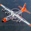 DG-C-130USAF 0002 A flying day-glow Lockheed C-130 Hercules USAF 80179 official Lockheed Aircraft photograph produced by Cloud 9 Photography