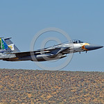 EE-F-15ANG 0036 A colorful McDonnell Douglas F-15 Eagle Oregon ANG jet fighter 79041 in rare special eagle markings makes a low fly-by at Kingsley Field during a Sentry Eagle exercise 7-2017 ...