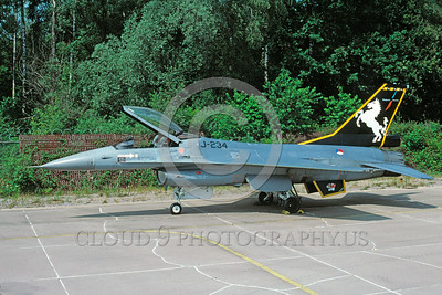 EE-F-16Forg 00027 A static colorful Lockheed Martin F-16 Fighting Falcon Dutch Air Force jet fighter 8-2004 military airplane picture via African Aviation Slide Service