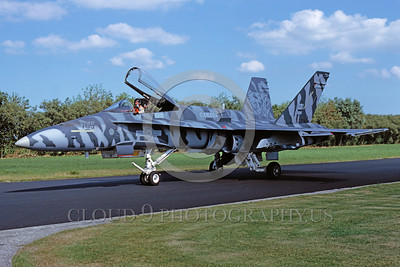EE-F-18Forg 0003 A taxing gray tone tiger striped McDonnell Douglas CF-18 Hornet Canadian Armed Forces jet fighter 10-1991 military airplane picture via African Aviation Slide Service