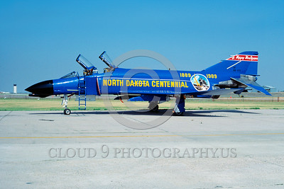 EE-F-4ANG 00003 A static colorful McDonnell Douglas F-4 Phantom II North Dakota ANG HAPPY HOLLIGANS North Dakota Centennial 8-1989 military airplane picture by H Homuth via African Aviation Slide Service