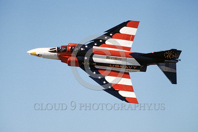 BIC-F4USN 00002 A flying colorful McDonnell Douglas F-4 Phantom II USN jet fighter VX-4 THE EVALUATORS bicentennial markings 1976 military airplane picture by Peter J Mancus