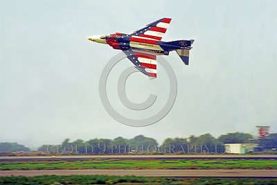 BIC-F4USN 00004 A flying colorful McDonnell Douglas F-4 Phantom II VX-4 THE EVALUATORS NAS Pt Mugu 1976 military airplane picture by Peter J Mancus
