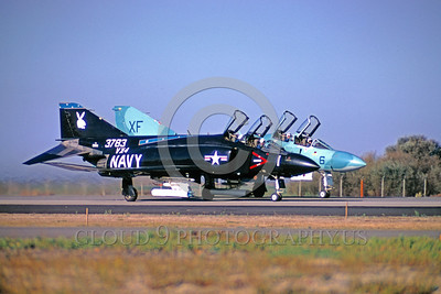 EE-F-4USN 00001 Two colorful McDonnell Douglas F-4 Phantom II's US Navy jet fighters, one black and one blue, taxi at NAS Pt Mugu VX-4 THE EVALUATORS 1973 military airplane picture by Peter J Mancus