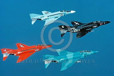 EE-F-4USN 00006 Four flying colorful McDonnell Douglas F-4 Phantom II US Navy jet fighters 2-1982 military airplane picture via African Aviation Slide Service