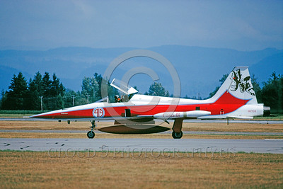 EE-F-5Forg 00002 A taxing colorful Northrop F-5E Freedom Fighter Canadian Armed Forces 116703 with large moose head on tail Abbottsford 8-1989 military airplane picture by Peter J Mancus
