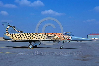 EE-Kfir 00001 A static colorful Israeil Aircraft Industries Kfir Sourth African Air Force jet fighter with large cheetah paint scheme 7-2002 via African Aviation Slide Service