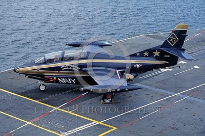 EE-T-2USN 00001 A static colorful North American T-2 Buckeye US Navy jet trainer 156721 USN 75th anniversary color scheme VT-26 FLYING TIGERS 5-1986 USS Lexington military airplane picture by Peter B Lewis