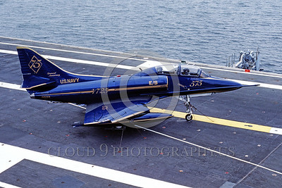 EE-TA-4J-USN 00001 A static blue Douglas TA-4J Skyhawk US Navy jet trainer VT-25 COURGARS 75th USN anniversary color scheme 5-1986 USS Lexington military airplane picture by Peter B Lewis